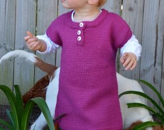 Size 2 100% merino wool hand knitted child's jumper dress