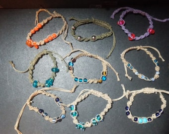 """Handmade, adjustable macreme bracelets. Made with hemp, glass bead, and plastic beads. One size fits most! 6"""" and up. L8"""
