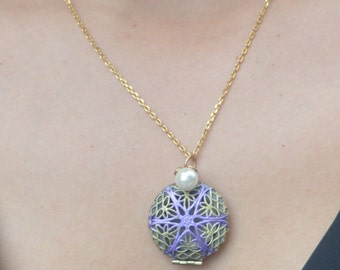 Beautiful medallion with a delicate pearl