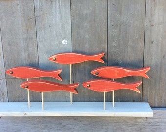 Add some fun and whimsy to your favorite room with the fabulous five. This colorful school of fish will accentuate any nautical decor.