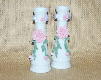Bone china vases, white ground, pink, white and green floral relief decoration 14cm tall