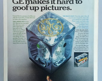 1968 GE Flash Cube Print Ad - with green dot, blue coat