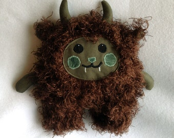 Brown and Green Happy Monster Plush Toy