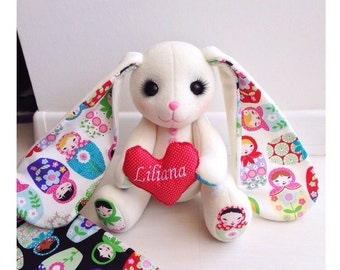 The handmade hare (rabbit) toy with Russian doll (matreshka) on the ears. Cotton and polar with hollowfiber inside.