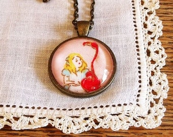Alice in Wonderland pendant necklace in antique bronze