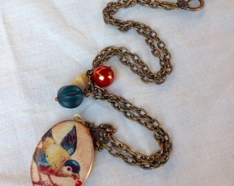 osO BLUE SWALLOW Oso brass locket