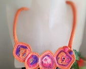 Free form crochet necklace Geometrical asymmetry in pink, orange and purple