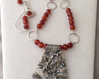 Unusual Sterling Silver pendant on hand formed sterling & fine silver chain, with red Chalcedony beads.