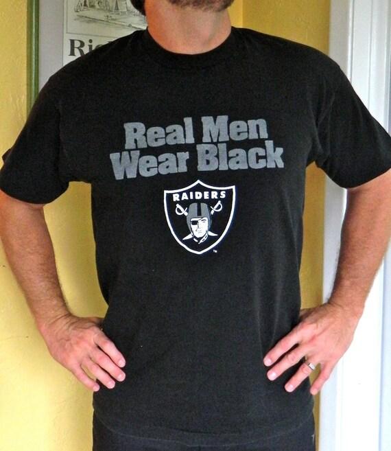real men wear black oakland raiders 1990s vintage shirt size
