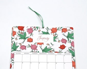 2016 Wall Calendar, size 8.5x11 inches featuring 12 different floral illustrations in green, peach, coral, pink and yellow