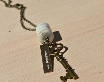 wanderlust stamped key necklace long