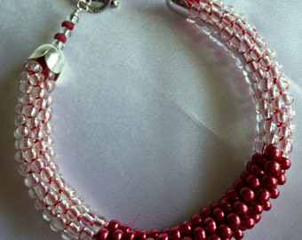 Metallic red and crystal beaded Kumihimo bracelet with silver plate accents