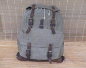 Vintage 1955's Swiss Army Green Salt And Pepper Large Size Canvas And Leather Backpack Bag
