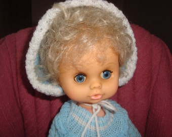 Beautiful blue eyed vintage 60s vinyl doll made in Hong Kong