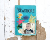 vintage book picture frame. READABLE vintage book as unique photo frame. By the Seashore, 1973. children's kid's book ocean sea shells