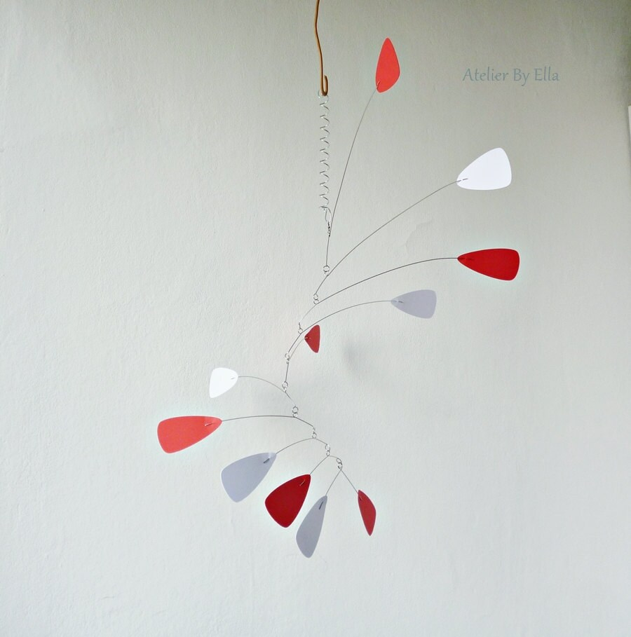 white and red hanging mobile calder inspired room decorart