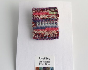 Tiny tapestry brooch, hand woven, pink, purple, red, made in Scotland