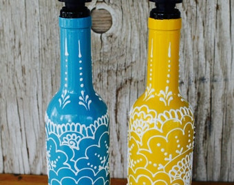 Olive oil and vinegar, simple syrup, soap, liquor dispenser bottles, hand painted bottles with intricate design, sunny yellow and sky blue