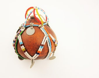 A Small Brown Gourd With Multi-colored Bead Girdle - Four-Junction Bead Cord Hanger - Collector - Small Clacking Disks - Small Plug in Gourd