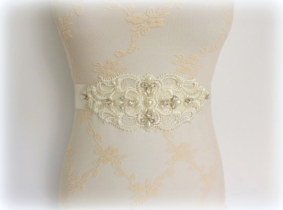 Ivory bridal sash. Lace centerpiece decorated with swarovski crystals and Ivory pearls.