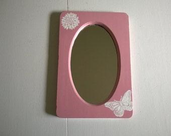 pink wall mirror