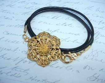 Leather wrap bracelet with gold filigree flower