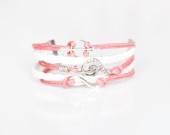 Treble Clef Arrow Infinity Peach Braided Bracelet.