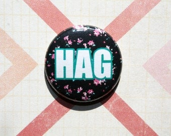 HAG- one inch pinback button