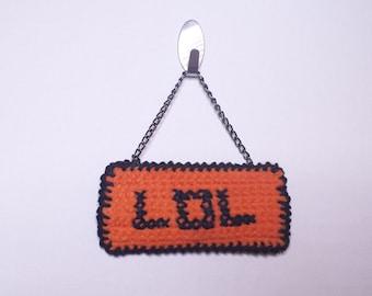 Crocheted/cross stitch sign, *LOL*