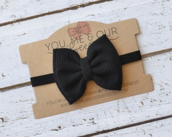 Black Bow Headband; Black fabric bow on a black elastic headband; baby, toddler, or girl's headband