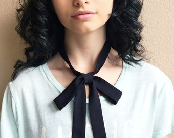"Ladies bow tie scarf 53""x1"" black silk skinny scarf. Ladies thin neck tie can be worn as a choker, hair tie or sash. 2 layers of pure silk."