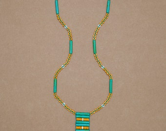 "Long beaded talisman necklace with cross pattern fringe in yellow, green turquoise & white ceramic beads. ""Ella"" from the Seaside Collectio"