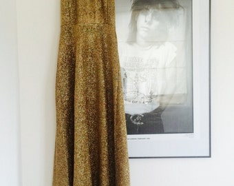Awesome 70's disco gold maxi halterneck dress. Fits a size small - medium