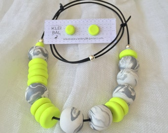 Neon yellow disk beads with grey and white marble beads.