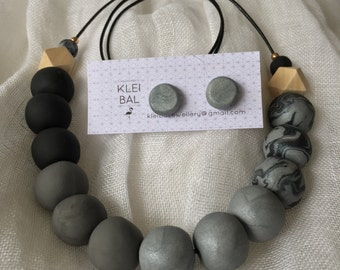 Mixed greys and black round beaded necklace with marble and wooden accent beads.