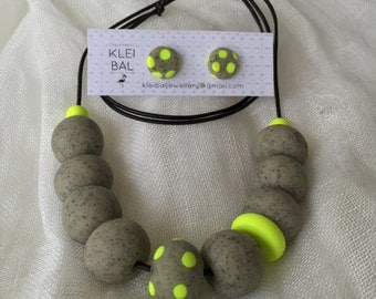 Mixed granite and neon yellow beaded necklace.
