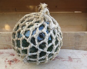 """5"""" vintage glass fishing float in sisal netting marked with dotted L marking"""