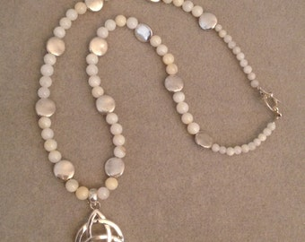 White Sea Sheel Beads and Silver Beads with Celtic Knot Necklace