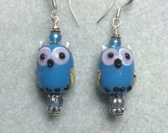 Blue lampwork owl bead earrings adorned with blue Czech glass beads.