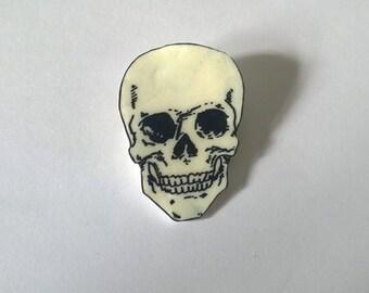 Hand drawn skull brooch