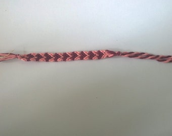 Pink and maroon heart friendship bracelet.