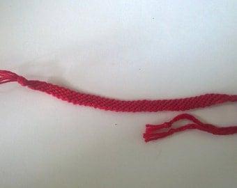 Dark pink friendship bracelet.