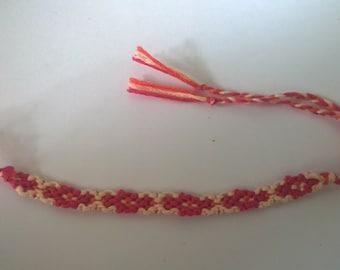 Assorted pink friendship bracelet.
