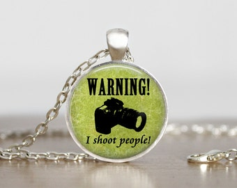 Warning I shoot people. Gift. Photographer. Comes as a necklace or keychain.