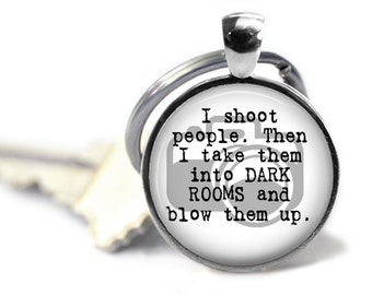 I shoot people, Then I take them into dark rooms and blow them up. Gift. Photographer. Comes as a necklace or keychain.