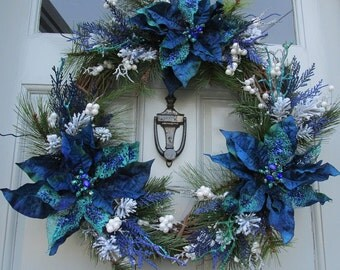 Winter Wreath with Blue, Turquoise, and White Jeweled Poinsettias, Frosted Pine, and White Berries
