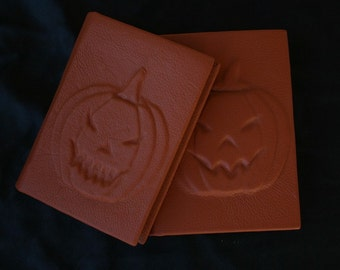 Handmade blank leather-bound journal Jack-o'-lantern