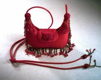 Elegant evening purse in designer's signature shape.