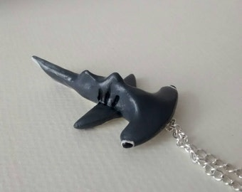 fun piece of polymer clay fimo jewellery. hammer head shark on a necklace chain.