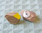 Olive wood studs, cut and decorated by hand, silver setting